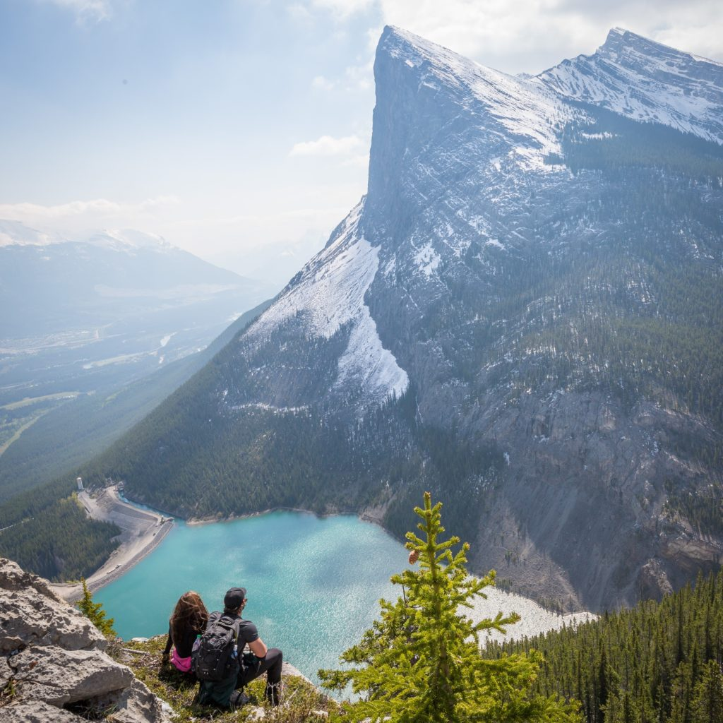 Environmental Action Shares: Couple gazes at mountain. (Photo by Kalen Emsley via Unsplash)