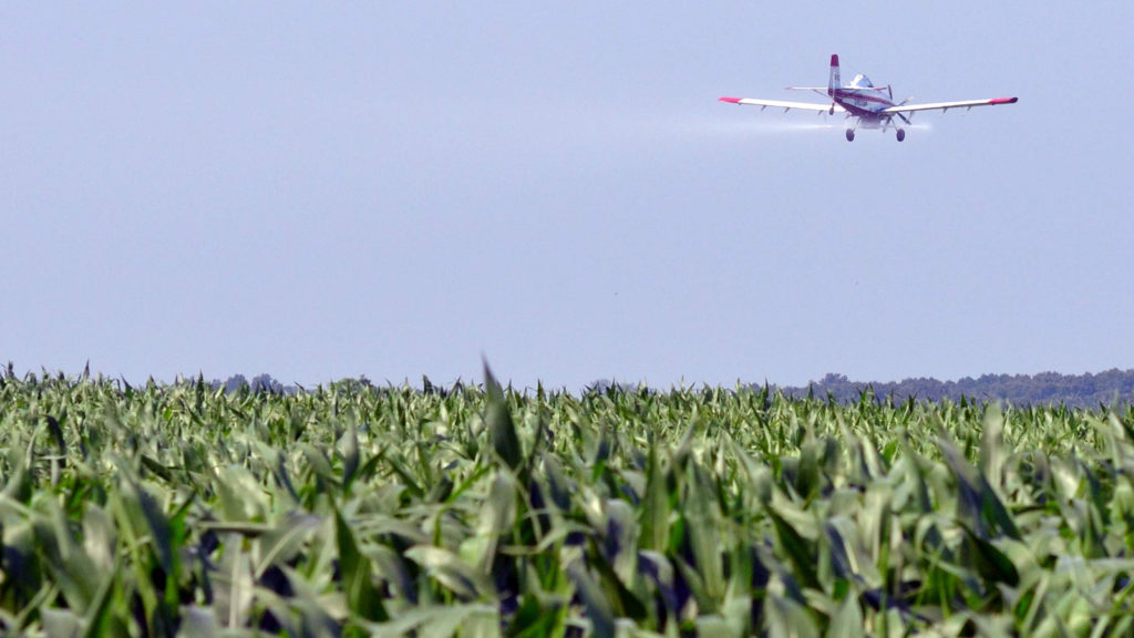 Ban Dicamba (Photo of cropduster, illustrating herbicide dispersal)