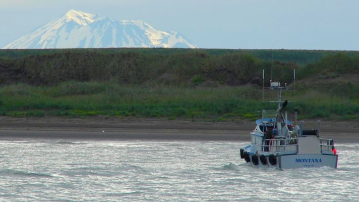 Boat in Bristol Bay with mountain in the background. Photo: Flickr user echoforsberg (CC 2.0)